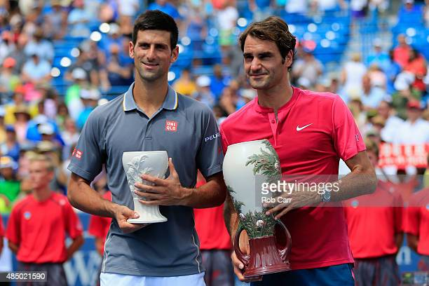 Roger Federer of Switzerland and Novak Djokovic of Serbia pose with the trophies after Federer won in two sets to win the mens singles final at the...