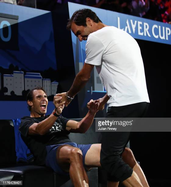 Roger Federer of Switzerland and Rafael Nadal of Spain celebrate the win by Alexander Zverev of Team Europe over Milos Raonic of Team World during...