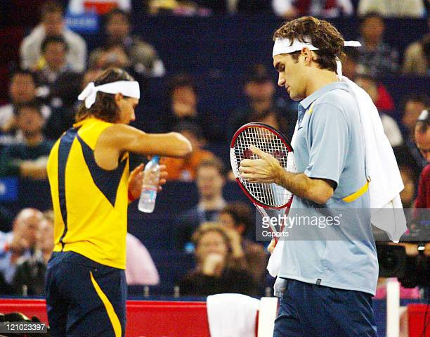 Roger Federer of Switzerland and Rafael Nadal of Spain during semifinals match at the Tennis Masters Cup in Shanghai China on November 18 2006