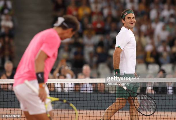 Roger Federer of Switzerland and Rafael Nadal of Spain play a tennis match at Cape Town Stadium as part of an exhibition game held to support the...
