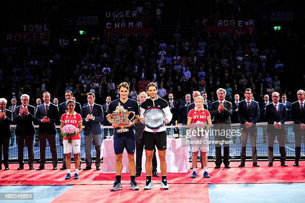 Roger Federer of Switzerland and Rafael Nadal of Spain pose with their trophies following the Swiss Indoors ATP 500 Final at St Jakobshalle on...