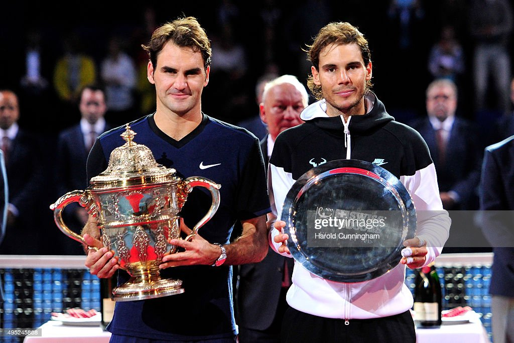 Roger Federer of Switzerland and Rafael Nadal of Spain pose with their trophies following the Swiss Indoors ATP 500 Final at St Jakobshalle on November 1, 2015 in Basel, Switzerland