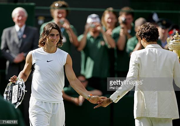 Roger Federer of Switzerland and Rafael Nadal of Spain shake hands after the men's final on day thirteen of the Wimbledon Lawn Tennis Championships...