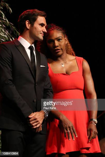 Roger Federer of Switzerland and Serena Williams of the United States share a moment on stage at the Hopman Cup New Years Eve Gala dinner during day...