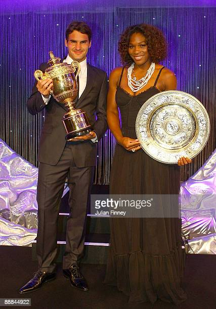 Roger Federer of Switzerland and Serena Williams of United States hold their Trophies at the Hotel Intercontinental on July 5 2009 in London England