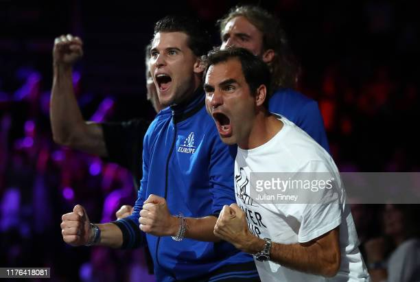 Roger Federer of Switzerland and team mates support Alexander Zverev of Team Europe against Milos Raonic of Team World during Day Three of the Laver...