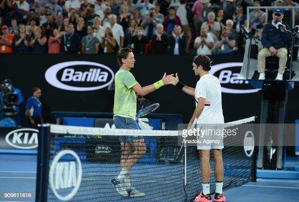 Roger Federer of Switzerland and Tomas Berdych of the Czech Republic congratulate each other after their match on day 10 of the 2018 Australian Open...