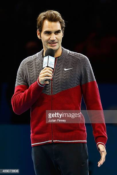 Roger Federer of Switzerland announces his decision to withdraw from the singles final match against Novak Djokovic of Serbia on day eight of the...