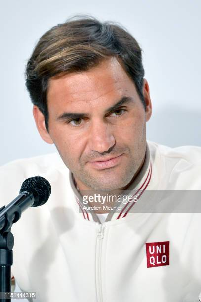Roger Federer of Switzerland answers journalists during a press conference ahead of the 2019 French Open at Roland Garros on May 24 2019 in Paris...