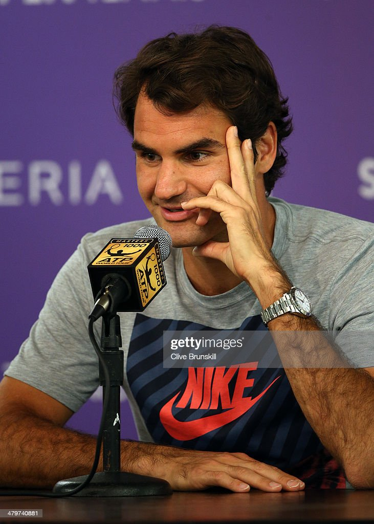 Roger Federer of Switzerland answers questions from the media during a press conference prior to his second round match during day 4 at the Sony Open at Crandon Park Tennis Center on March 20, 2014 in Key Biscayne, Florida.