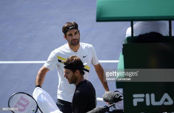 Roger Federer of Switzerland argues with chair umpire Fergus Murphy as Juan as Martin Del Potro of Argentina walks to his seat during the second set...