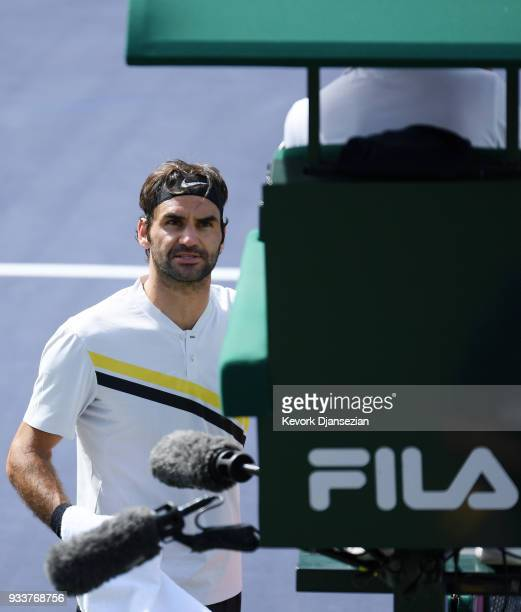 Roger Federer of Switzerland argues with chair umpire Fergus Murphy Juan as Martin Del Potro of Argentina walks to his seat during the second set of...