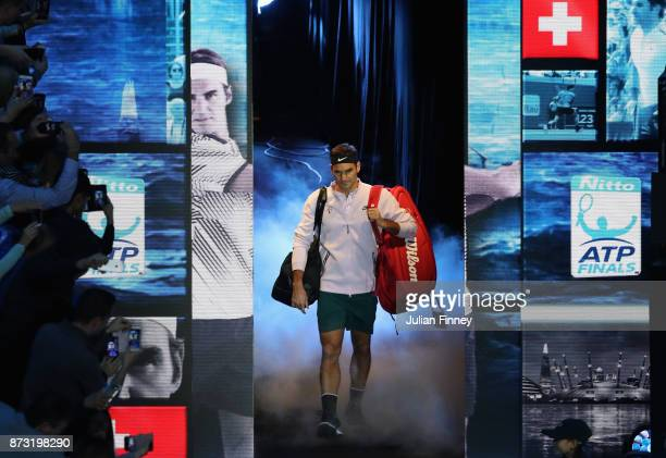 Roger Federer of Switzerland arrives on court before his match against Jack Sock of USA during day one of the Nitto ATP World Tour Finals tennis at...