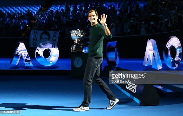 Roger Federer of Switzerland arrives on court with the Norman Brookes trophy during the 2018 Australian Open Official Draw at Melbourne Park on...
