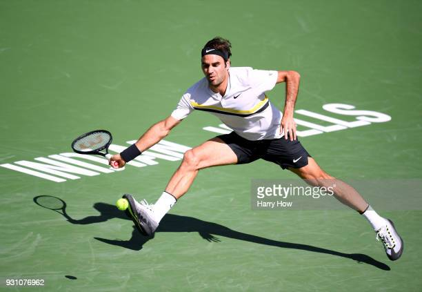 Roger Federer of Switzerland attempts a running forehand in his match against Filip Krajinovic of Serbia during the BNP Paribas Open at the Indian...