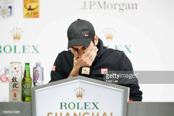 Roger Federer of Switzerland attends a press conference after defeat by Borna Coric of Croatia during their Singles - Semifinals match of the 2018...