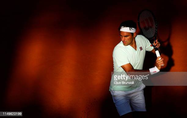 Roger Federer of Switzerland bakchand against Borna Coric of Croatia in their Men's Singles Round of 16 match during Day Five of the International...