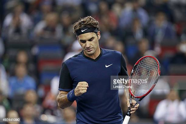 Roger Federer of Switzerland celebrates a point against Albert RamosVinolas of Spain during their men's singles second round match on day 3 of...