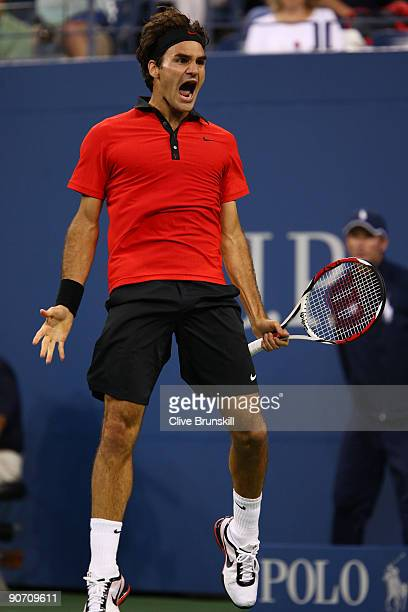 Roger Federer of Switzerland celebrates a point against Novak Djokovic of Serbia during the Men�s Singles Semifinal match on day fourteen of the 2009...