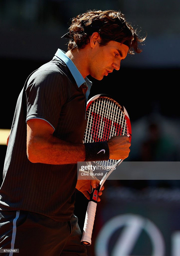 Roger Federer of Switzerland celebrates a point against Rafael Nadal of Spain in the mens final during the Madrid Open tennis tournament at the Caja Magica on May 17, 2009 in Madrid, Spain.
