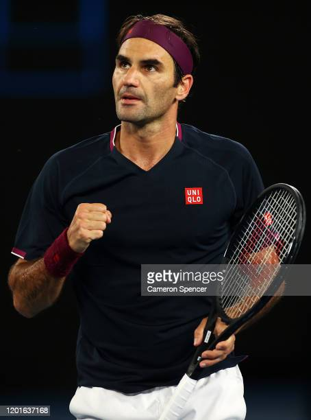 Roger Federer of Switzerland celebrates a point during his Men's Singles third round match against John Millman of Australia on day five of the 2020...