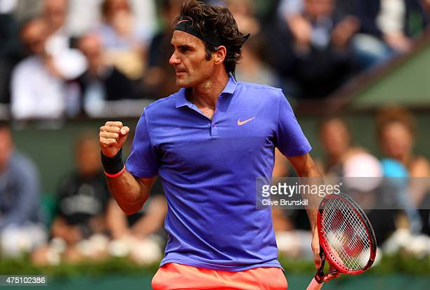 Roger Federer of Switzerland celebrates a point in his Men's Singles match against Damir Dzumhur of Bosnia and Herzegovina on day six of the 2015...