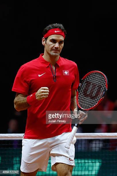 Roger Federer of Switzerland celebrates a point with Stanislas Wawrinka of Switzerland against Richard Gasquet of France and Julien Benneteau of...