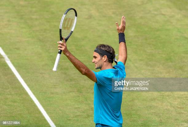 Roger Federer of Switzerland celebrates after defeating Australia's Matthew Ebden in their match at the ATP tennis tournament in Halle western...