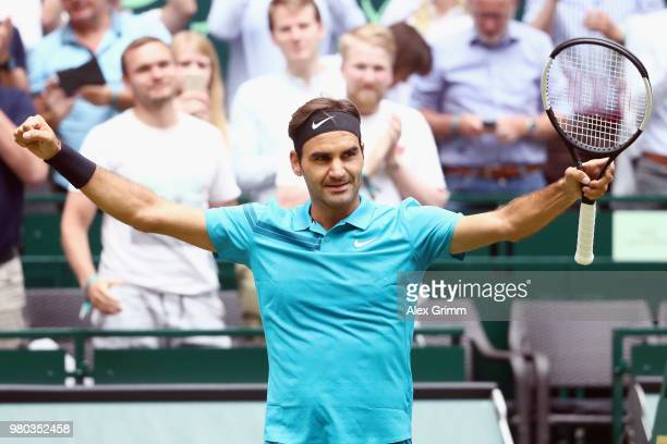 Roger Federer of Switzerland celebrates after defeating Benoit Paire of France during their round of 16 match on day 4 of the Gerry Weber Open at...