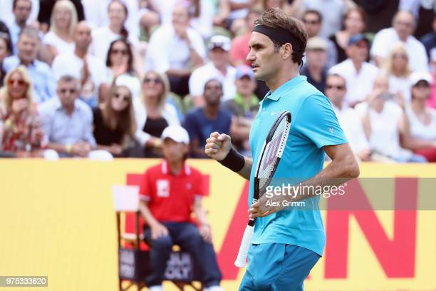 Roger Federer of Switzerland celebrates after defeating Guido Pella of Argentina during day 5 of the Mercedes Cup at Tennisclub Weissenhof on June...