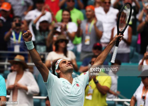 Roger Federer of Switzerland celebrates after defeating John Isner in straight sets during the Men's Final match on day 14 of the Miami Open...
