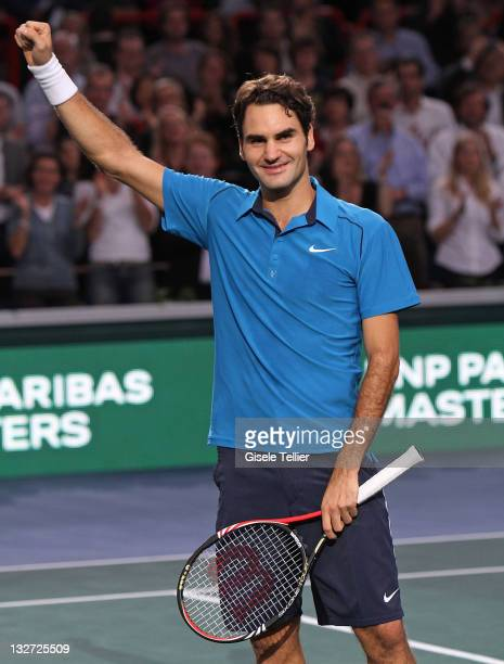Roger Federer of Switzerland celebrates after defeating JoWilfried Tsonga of France in the finals of the BNP Paribas Masters at Palais Omnisports de...