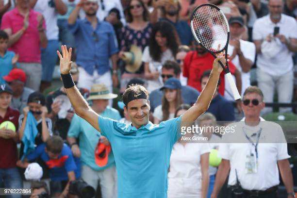 Roger Federer of Switzerland celebrates after defeating Nick Kyrgios of Australia and returning to the top position in the ATP global ranking during...