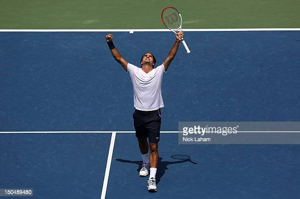 Roger Federer of Switzerland celebrates after defeating Novak Djokovic of Serbia during the final on day nine of the Western Southern Open at Lindner...