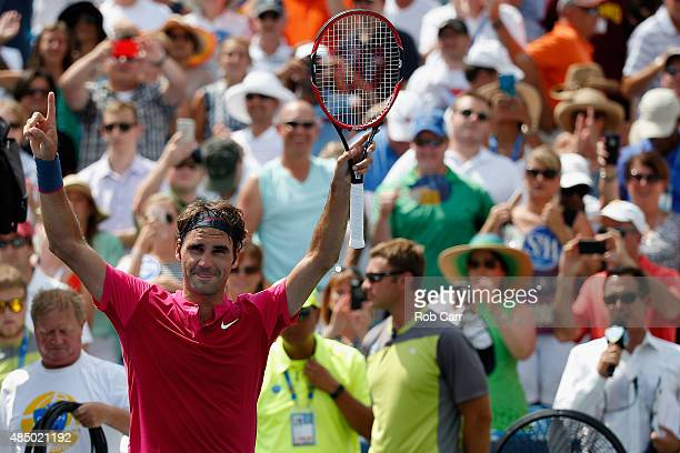 Roger Federer of Switzerland celebrates after defeating Novak Djokovic of Serbia to win the mens singles final at the Western Southern Open at the...