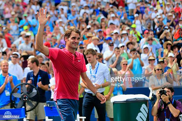 Roger Federer of Switzerland celebrates after defeating Novak Djokovic of Serbia to win the mens singles final at the Western & Southern Open at the...