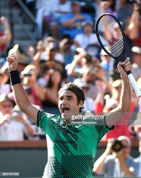 Roger Federer of Switzerland celebrates after defeating Stanislas Wawrinka of Switzerland in the mens final during day fourteen of the BNP Paribas...