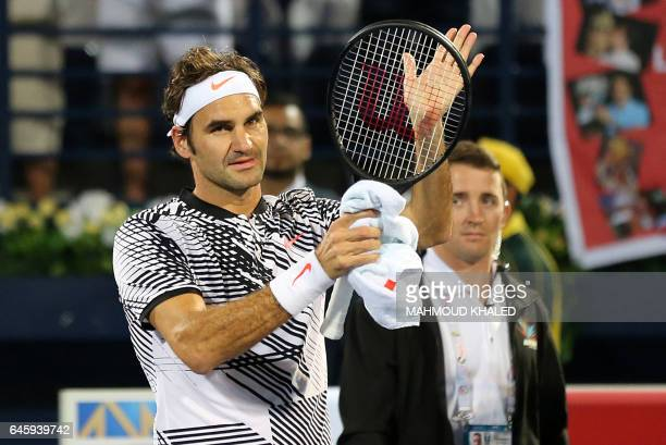 Roger Federer of Switzerland celebrates after winning against France's Benoit Paire at the end of their ATP tennis match during the Dubai Duty Free...