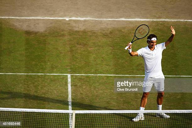 Roger Federer of Switzerland celebrates after winning his Gentlemen's Singles semifinal match against Milos Raonic of Canada on day eleven of the...
