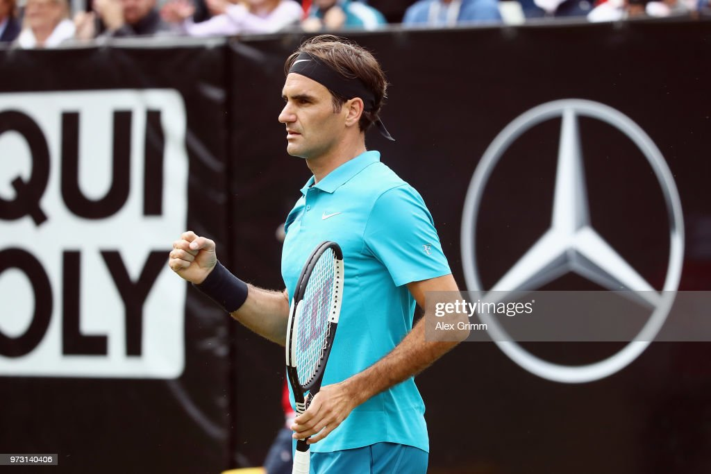 Roger Federer of Switzerland celebrates after winning his match against Mischa Zverev of Germany during day 3 of the Mercedes Cup at Tennisclub Weissenhof on June 13, 2018 in Stuttgart, Germany. Roger Federer debuts his new Wilson Pro Staff RF 97 Autograph racket at the 2018 Mercedes Cup in Stuttgart. The white and black design of the racket was inspired by the classic tuxedo, or dinner suit, and Federer's timeless and elegant sense of style.