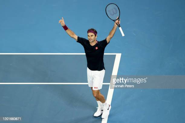 Roger Federer of Switzerland celebrates after winning his Men's Singles third round match against John Millman of Australia on day five of the 2020...