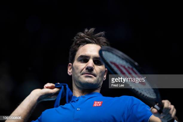 Roger Federer of Switzerland celebrates after winning his singles round robin match against Dominic Thiem of Austria during Day Three of the Nitto...