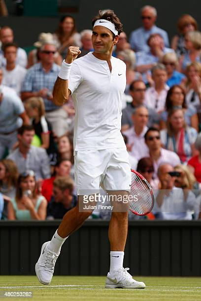 Roger Federer of Switzerland celebrates after winning match point in the Gentlemens Singles Semi Final match against Andy Murray of Great Britain...