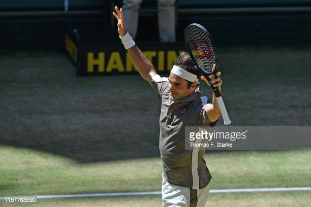 Roger Federer of Switzerland celebrates after winning the final match against David Goffin of Belgium during day 7 of the Noventi Open at Gerry Weber...