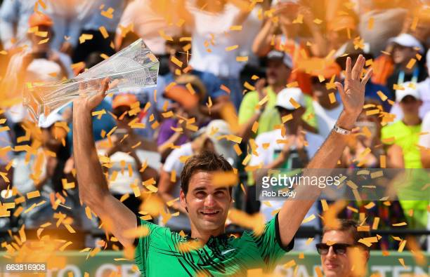 Roger Federer of Switzerland celebrates after winning the final match against Rafael Nadal of Spain on day 14 of the Miami Open at Crandon Park...