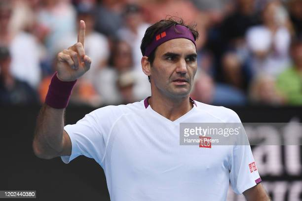 Roger Federer of Switzerland celebrates after winning the fourth set during his Men's Singles Quarterfinal match against Tennys Sandgren of the...