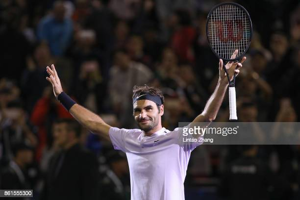 Roger Federer of Switzerland celebrates after winning the Men's singles final against Rafael Nadal of Spain on day eight of 2017 ATP Shanghai Rolex...