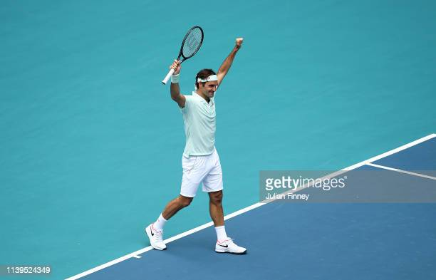 Roger Federer of Switzerland celebrates at match point against John Isner of USA in the final during day fourteen of the Miami Open tennis on March...