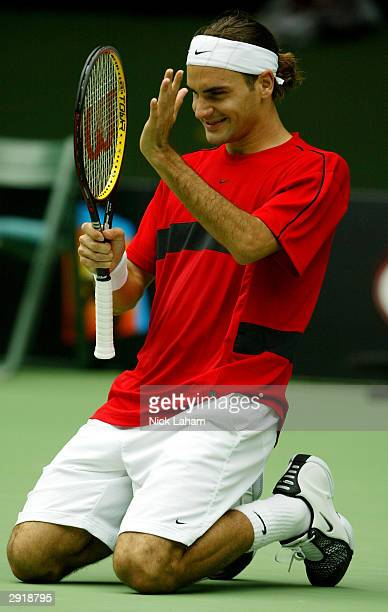 Roger Federer of Switzerland celebrates Championship point and his victory against Marat Safin of Russia during the Mens Singles Final during day...