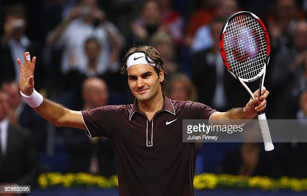 Roger Federer of Switzerland celebrates defeating Evgeny Korolev of Russia during Day Five of the Davidoff Swiss Indoors Tennis at St Jakobshalle on...